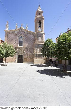 Cambrils, Spain, May 1, 2020 - Facade Of Santa Maria Church In Old Town. City Clock On Bell Tower Of