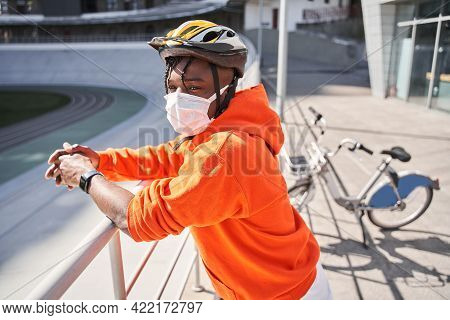 Man Wearing Protective Mask Standing At The Street And Waiting