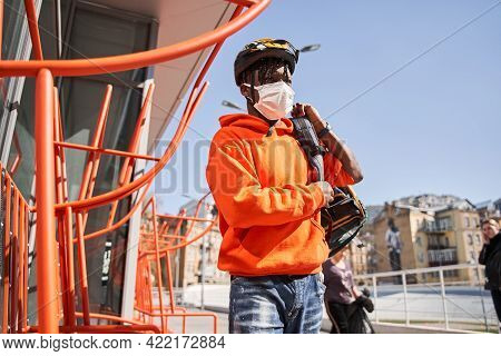 Delivery Man Wearing Protective Mask Going To His Client With Bag With Parsels