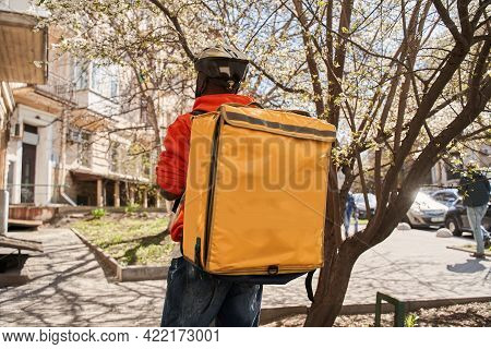 Man With Backpack With Food Looking For The Route While Going To The Client