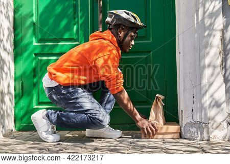 Woman Courier Delivered The Order Bag With Food To The Door