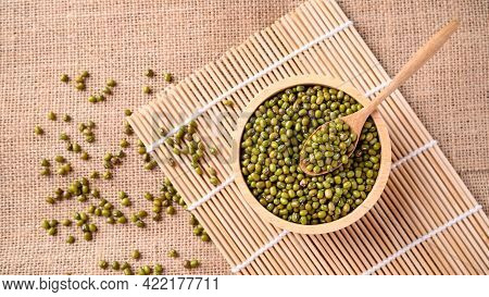 Mung Bean Seeds In A Wooden Spoon And Bowl, Food Ingredients In Asian Cuisine And Produce Mung Bean