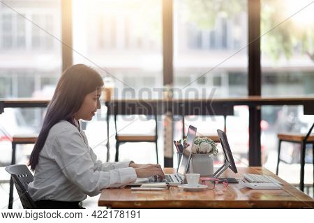 Young Accountant Woman Checking Paperwork From Accounting Department To Analyse Number On Document,