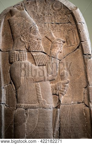 Berlin, Germany - 18 September 2019: Babylonian bas relief in Berlin Pergamon museum in Germany. Historical ancient art of east religion and civilization made on stone wall.