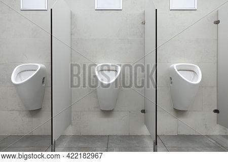 Row Of Urinal Toilet Blocks In Men Public Toilet Or Restroom
