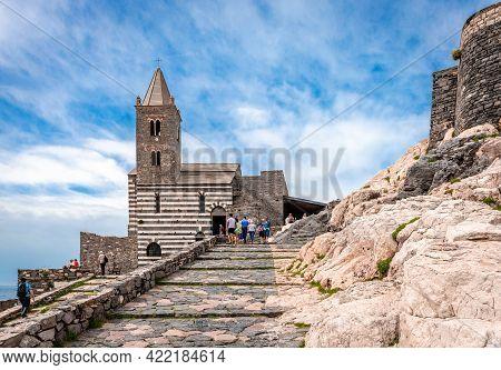 Porto Venere, Italy - May 28 2018: The Church Of St. Peter And The Square Spallanzani. The Roman Cat