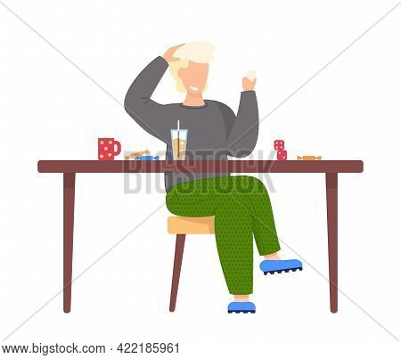 Man Sits On Chair Near Brown Table With Sweets, Cup, Glass Of Juice And Dice. Boy Smiles And Plays B