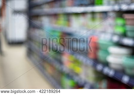 Abstract Blurred Shelving With Goods In Retail Store In Mall For Background