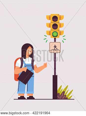 Schoolgirl With Backpack Waiting For Green Traffic Light To Cross Road On Crosswalk Road Safety Conc