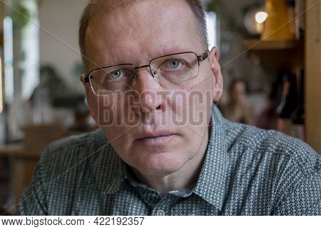 Candid Mature Man In Eyewear Looking Seriously To Camera With Real Emotions Of Attention Or Fear.