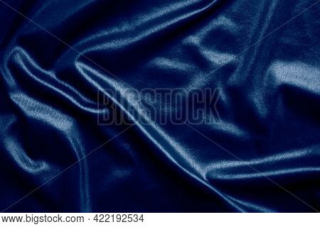 Dark Blue Silk Texture Abstract Background. New Modern Design Luxurious Light And Soft Wave Smooth S