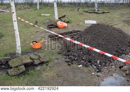 Soil With Shovels. Close-up, Digging A Grave.