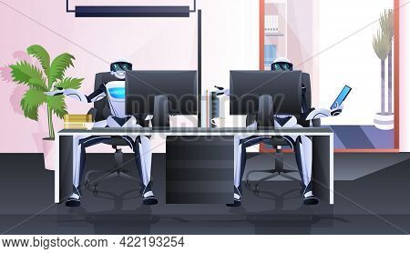 Robots Sitting At Workplace Robotic Businesspersons Working In Office Artificial Intelligence Techno