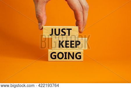 Just Keep Going Symbol. Wooden Blocks With Words 'just Keep Going'. Beautiful Orange Background, Bus