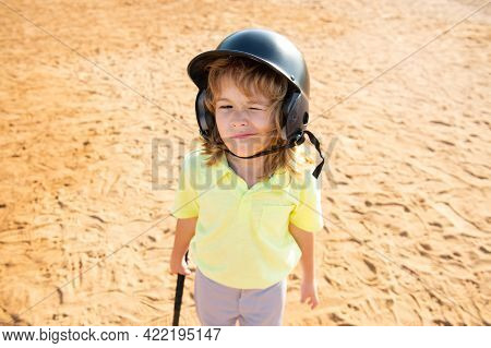 Funny Child Playing Baseball, Winking. Batter In Youth League Getting A Hit. Boy Kid Hitting A Baseb