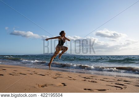 Woman Running Silhouette. Run On Sea. Sport Exercise At Beach Concept.