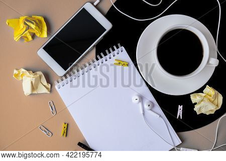 Cup Of Black Coffee On Vynil Record. Notebook Copy Space. Listening To Music. Retro Style. Mobile Ph
