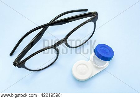 Container With Contact Lenses And Glasses With Black Frames, Vision Correction Concept,ophthalmology