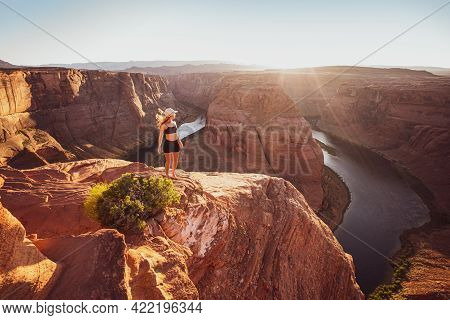 Young Woman Looking To Horseshoe Bend And Colorado River. Famous Hiking Place. Glen Canyon, Arizona,