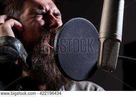 Expressive Face Closeup. Handsome Man In Recording Studio. Music Performance Vocal. Singer Singing S