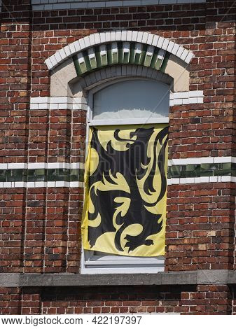 The Flemish Flag, Yellow With A Black Flemish Lion In Front Of A Window Of A House