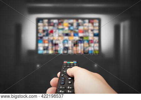 Video On Demand, Tv Streaming, Multimedia. Hand Holding Remote Control