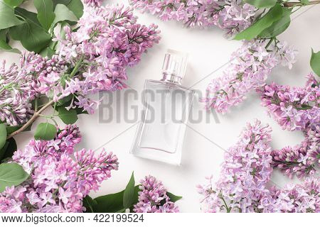 A Bottle Of Perfume And Lilac On A White Background . Women's Perfume. Spring Fragrance. Aromatherap