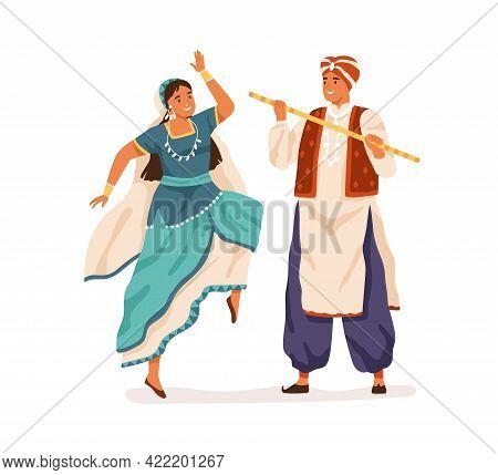 Dancers Performing Indian Folk Dance, Dandiya Raas. Man And Woman Dancing In Traditional Costumes Of