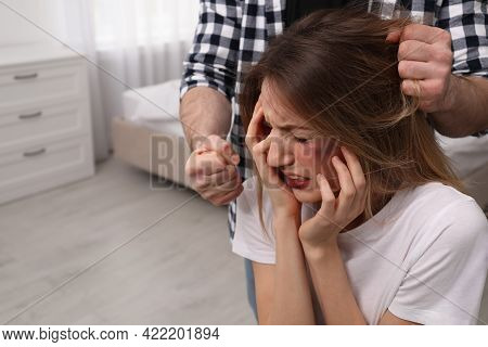 Man Abusing Scared Woman In Bedroom. Domestic Violence