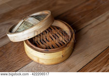 Bamboo Steamer Set, Chinese Kitchenware On Wooden Table, Top View. Empty Traditional Asian Bamboo St