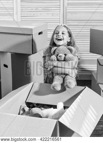 Urban Location. Happy Little Girl With Toy. Purchase Of New Habitation. Moving Concept. New Apartmen