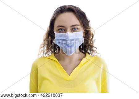 Woman Wearing Face Mask At Home. Covid-19 Virus Protection.