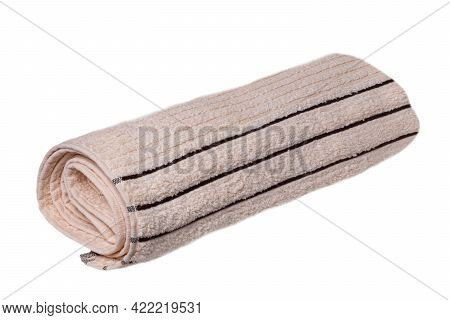 Towels Isolated. Closeup Of A Rolled Up Beige Soft Terry Bath Towel Isolated On A White Background.