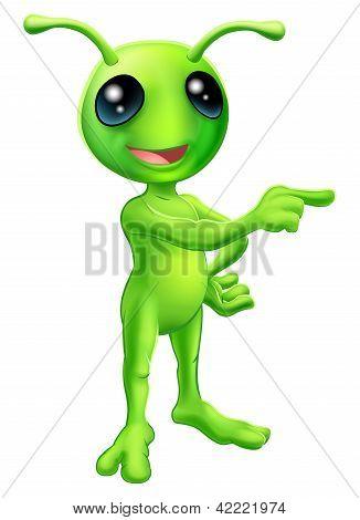 Alien de dibujos animados lindo apuntando