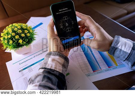 Chiang Mai, Thailand May 26 2021: Businessman Using Teamviewer Application On Apple Iphone Xi To Onl