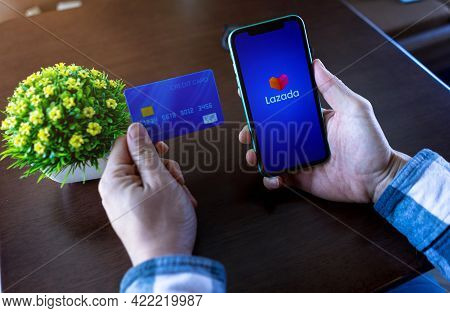 Chiang Mai, Thailand, May 22, 2021 Young Male Online Shopping By Lazada And Pay By Credit Card. Best