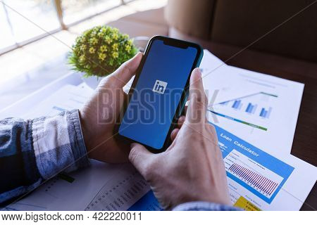 Chiang Mai, Thailand, May 25, 2021 Young Male Holding Apple Iphone Xi With Linkedin Application On T