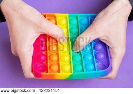Woman Play In Sensory Anti Stress Pop It Simple Dimple In Square Shape Toy. Push Pop Bubble Flexible