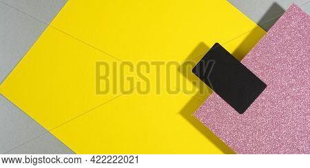 Blank Black Rectangular Business Card On A Creative Background From Sheets Of Paper With Shadow, Gra