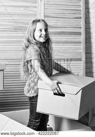 Big Storage Space. Box Package And Storage. Small Child Prepare For Relocation. Relocating Family St