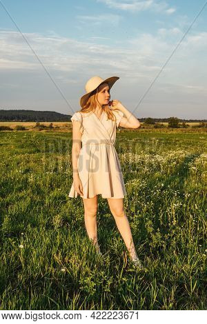 Woman In Dress Stand In The Field