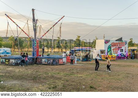 Manacor, Spain; May 28 2021: People Enjoying A Fair Attraction With A Face Mask Because Of The Coron