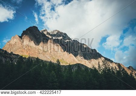 Scenic Mountain Landscape With Great Rocks In Golden Sunlight Above Forest. Awesome Rocky Wall With