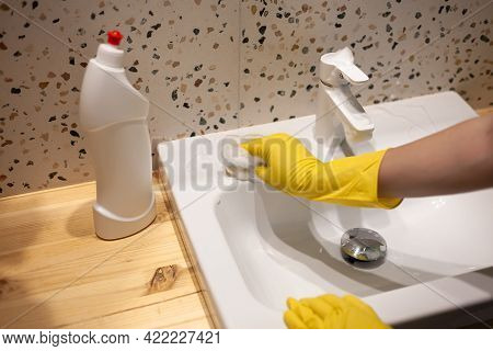 Female Hands Cleaning Bathroom Washing Washbasin In Protective Gloves At Home