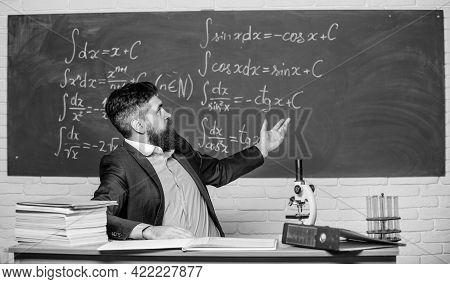 Teaching And Education. University Teacher Use Teaching Aids. Bearded Man Teaching Chemistry In Scho