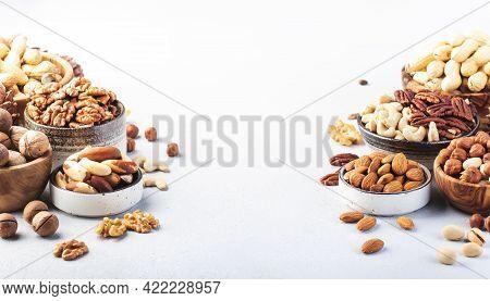 Assortment Of Nuts. Cashews, Hazelnuts, Walnuts, Almonds Etc. Healthy Food Snacks Mix On Gray Backgr