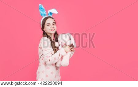 Ready For Party. Happy Childhood. Cheerful Bunny Kid Play With Toy. Copy Space. Happy Easter Holiday