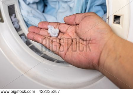 Hand Holding Lint Removed From Laundry Dryer Filter