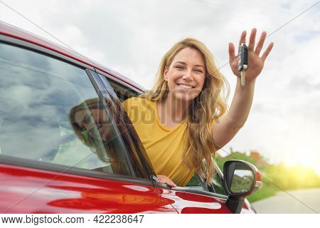 Attractive Young Woman Shows The Keys To The Car. Beautiful Joyful Girl In The Car.