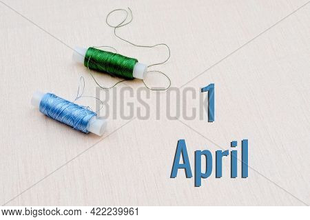 Handicraft Calendar 1 April. Skeins Of Green And Blue Threads For Embroidery On Beige Background. Ha
